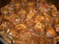 Savory oxtail in a rich and thick gravy. Hearty oxtail in a rich and thick sauce. Jamaican Oxtail, Jamaican Cuisine, Jamaican Dishes, Jamaican Recipes, Beef Recipes, Cooking Recipes, Jamaican Chicken, Entree Recipes, Sauce Recipes
