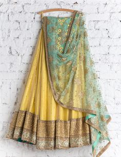 Shop beige with gleeful resham designer lehenga choli online.This set is features a pale turquoise blouse in silk embroidery and resham work.It has matching beige lehenga in net with beautiful embroidery all over and pale turquoise dupatta in net with lac Yellow Lehenga, Red Lehenga, Lehenga Choli, Sarees, Sharara, Bridal Lehenga, Sabyasachi, Pakistani Bridal, Indian Bridal
