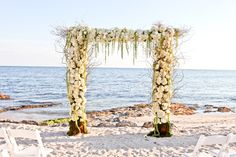 Intimate destination wedding at Casa Marina in Key West, Florida at sunset.  Photography by Small Miami Weddings.  www.smallmiamiweddings.com
