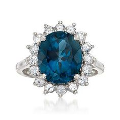 Regal, romantic and remarkably affordable. London blue topaz centerpiece encircled by white topaz. Sterling silver ring. Similar design to Kate Middleton's ring. >>Click on the pin to see more Lady Diana ring styles at Ross-Simons.