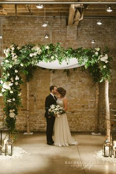 Birch chuppah canopy with white flowers and green foliage by Rachel A. Clngen of Toronto. www.rachelaclingen.com