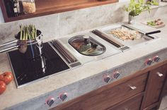 Gaggenau's  Vario Induction cooktop, Teppan Yaki and Steamer with downdraft ventilation units between.