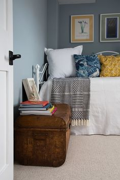 A beautiful white metal day bed in this rustic country cottage retreat in East Sussex. Dressed in a white quilt with blue and yellow vintage inspired cushion this bed looks so cool next to the antique metal trunk acting as a bedside table. Part of a stunning design of a a grade 2 list property by Smartstyle Interior Photo credit Daniela Exley!