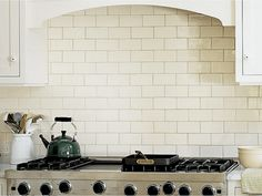 love the cream 3x6 tiles with brown grout and cream cabinets