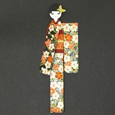 Handmade bookmark / Kimono paper doll / Yuzen washi origami paper. €4.50, via Etsy.