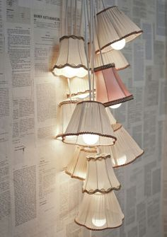 "Vintage lamp shades, but I'm also intrigued by the ""wall paper."" I might be able to do that with the left overs from my book purses for art crawl! Lamp shades and wall paper, but the wall paper I saw of invention sketches. Luminaria Diy, Recycled Lamp, Retro Lampe, Deco Luminaire, Best Decor, Home And Deco, Lamp Shades, My New Room, Lamp Light"