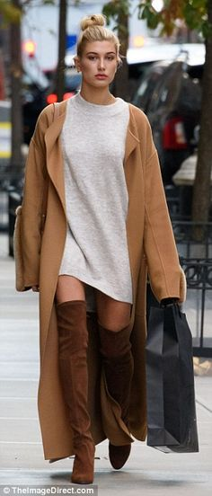 High end boots: Hailey Baldwin's brown suede Stuart Weitzman thigh high's retail for almost $800