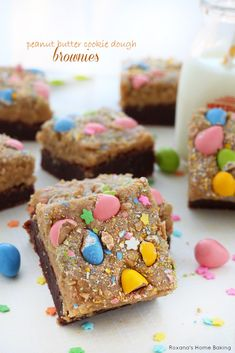 These peanut butter cookie dough brownies feature fudgy homemade brownies topped with a thick layer of creamy peanut butter cookie dough and colorful candy.