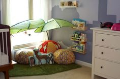 Cute 'park in the city' themed reading nook - leaf canopies, floor rugs, shelves & dresser all from Ikea
