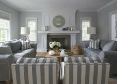Grey lounges Match armchair with cushions. i like this fireplace
