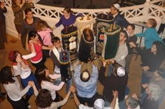 About Simchat Torah: Rejoicing in the Torah.    On Simchat Torah, we celebrate the completion of once again finishing the reading of the Five Books of Moses.   Then, we begin anew with Genesis.