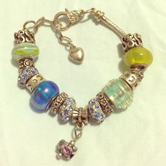 """Euro Charm Bracelet Silver Italian / European style charm bracelet. Light blue crystal accents and mixture of green and blue beads. 8"""" long with multiple size adjustment loops. **Sterilized and dried before shipping. Smoke free home.** Jewelry Bracelets"""