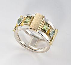 Ring | Janis Kerman. Sterling silver, 18kt yellow gold, peridot, aquamarine.