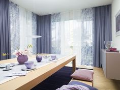 Dining room in blue, violet scenery - a combination of three different fabric designs