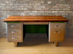 Brushed tanker desk with reclaimed wood top.