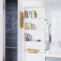 Kitchen storage and blackboard