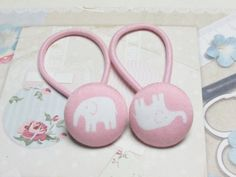 Check out this item in my Etsy shop https://www.etsy.com/listing/256748178/button-ponytail-holders-pink-ponytail