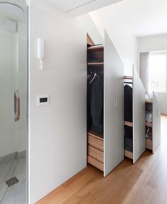 Utilizing under-stair storage and other clever built-ins, Studio Bazi has designed a compact but efficient apartment in a historic building in Moscow. Micro Apartment, Tiny Apartments, Small Space Storage, Storage Spaces, Hidden Storage, Hidden Kitchen, Kitchen Small, Laundry Room Storage, Storage Room
