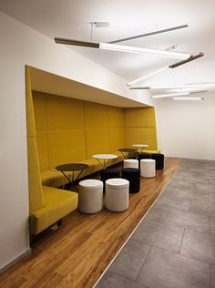 "children's waiting room; add ""padded"" color wall with bench seating; Turkcell Maltepe Plaza by mimaristudio"