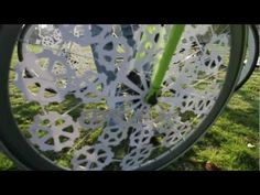 Watch as a bicycle wheel creates an animation by Katy Beveridge. She uses cut up paper placed on a bicycle wheel and captures the motion with a video camera.
