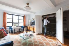 Daniel lives in a small studio apartment made ultra functional thanks to a stylish Murphy bed.