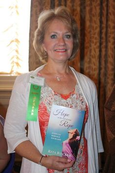 """Book signing for """"Hope at the End of Your Rope: Steps to Rebuild Your Life"""" at the Professional Woman Network international conference August 2014."""