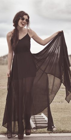 Draping chiffon dress with laced up heeled boots - http://ninjacosmico.com/11-ways-wear-black-dresses-summer/