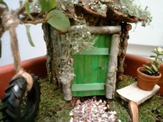 birdhouse, door made of twigs and popsicle sticks