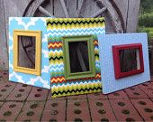 Picture frames/fabric covered.....done in beautiful coordinating fabrics of blue,yellow and green....can also be ordered individually.