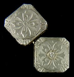 Antique white gold cufflinks featuring dramatic floral and cruciform motifs above a field of concentric circles.  The edges are embellished with flame scrolls (or acanthus leaves) at the canted corners with elongated Greek key designs in between.  One side is set with a small diamond.  A nice example of the effusive Art Deco designs of the 1920s.  Crafted in 14kt gold,  circa 1925.