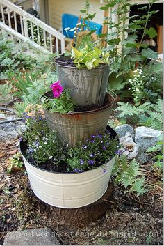 buckets planters - this would be cute with a mailbox coming out of the top one, too.