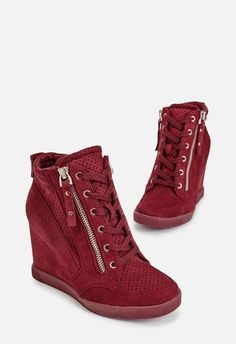 Kick back in these trendy sneakers featuring a faux leather construction and inner and outer zip closures for both convenience and style.  ...