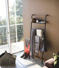 Black Steel & Wood Wide Leaning Ladder Hanger Possibly do this with piping and wooden shelves?