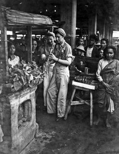 """Army nurses Alice Clark (right) and Shirley """"Corky"""" McCorquodale Lyle (left) at a marketplace in Mindanao, Philippines, 1945 ~"""