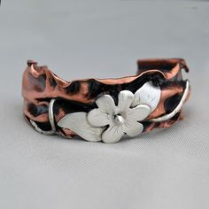 Cuff | Cyndie Smith.  Sterling silver and copper.