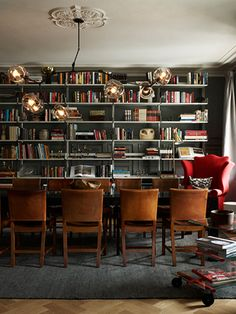 dining-rooms-offices-brown-gray-bookcases-books-bookshelves-chandeliers-dining-chairs