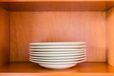 Wood Kitchen Cabinet with White Bowls