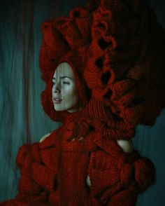 """Sandra Backlund has a sculptural approach from a variety of materials. She experiments with knitting and constructs elaborate knitted pieces and garments. She especially explores textures, volumes and silhouettes, using plain colours to highlight the volume and shapes. Her results are explained as a """"hybrid between fashion, sculpture and handicraft"""""""