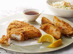 Fish and chips.: 2 large  baking potatoes,cut into 8 wedges   1/4 c  zesty italian dressing   1 pkg  shake n bake extra crispy seasoned coating mix, divided   4  fish fillets   1/4 c  miracle whip light dressing