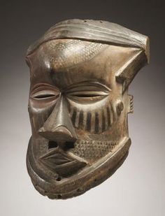 Democratic Republic of the Congo, Kuba people, mid-late 19th century Medium: wood and pigment This particular mask is called a bwoom because it represents a commoner or a pygmy. When people wore the Bwoom Helmet mask they would also cover every part of their body to give a more authentic representation of a spirit