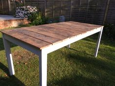 Outdoor dining table...I'm imagining this with mismatched chairs...