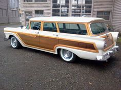 1957 Ford White Country Squire Woody Station Wagon.