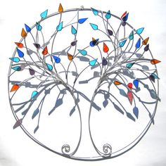 "seasoned leaves - branches are made from wire, with blue, turquoise, teal green, amber, purple, and red-orange leaves.    Dimensions - 15"" in diameter"