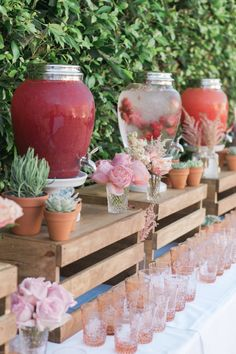 Water with fresh fruit, and juice station. This display is inspiring our next summer party.
