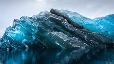 a photograph of an upside down iceberg.