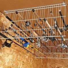 Clever Storage Ideas for Hard-to-Store Stuff Wire shelving into rack for fishing poles! (from 18 life-changing storage ideas)Wire shelving into rack for fishing poles! (from 18 life-changing storage ideas) Diy Organisation, Garage Organization, Organizing Tips, Organized Garage, Ideas For Shed Organization, Fishing Pole Storage, Fishing Poles, Ice Fishing, Bass Fishing