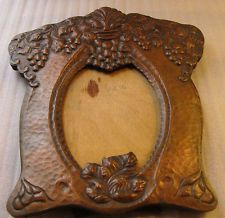.(note to self;  can't tell if this is carved wood or metal tooled....but would make a good pattern for tooling)