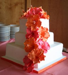 Gumpaste Hibiscus Wedding cake - These were my first ever gumpaste hibiscus flowers.  The colors were mango and guava hand crafting.