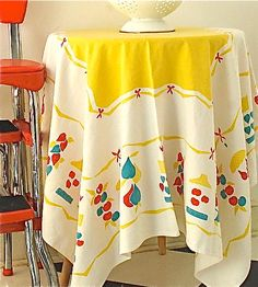 vintage tablecloth: my mom just gave me one like this today. It has more red in it and a grocery list theme. Too cute!
