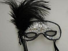 Feathered Silver Sequin Mask on a Stick